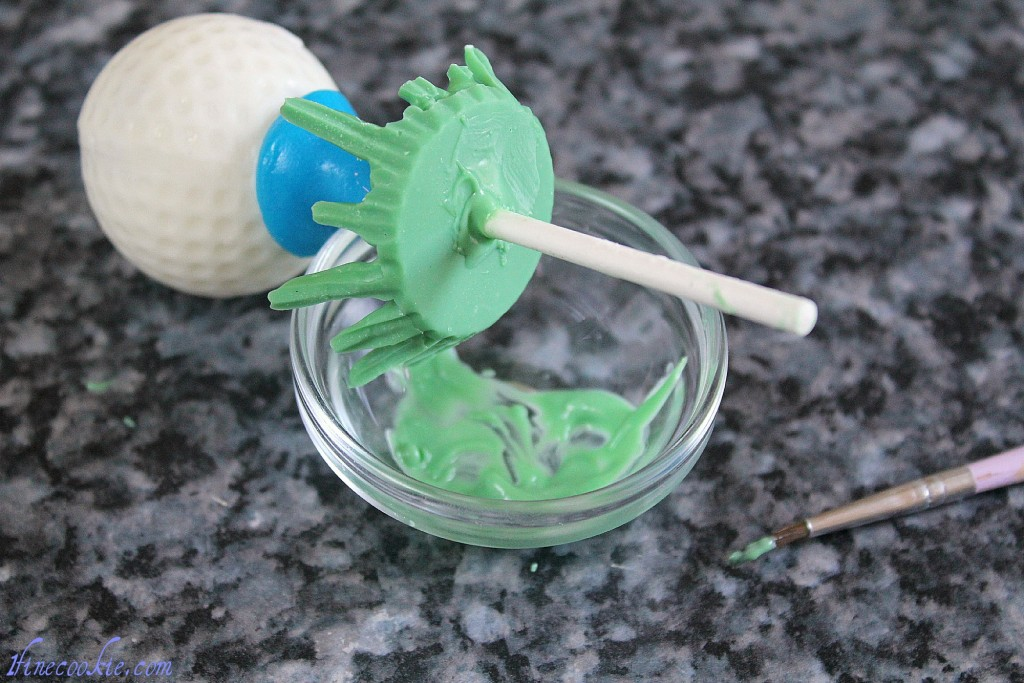 Slide pops onto grass, golf ball cakes pops,
