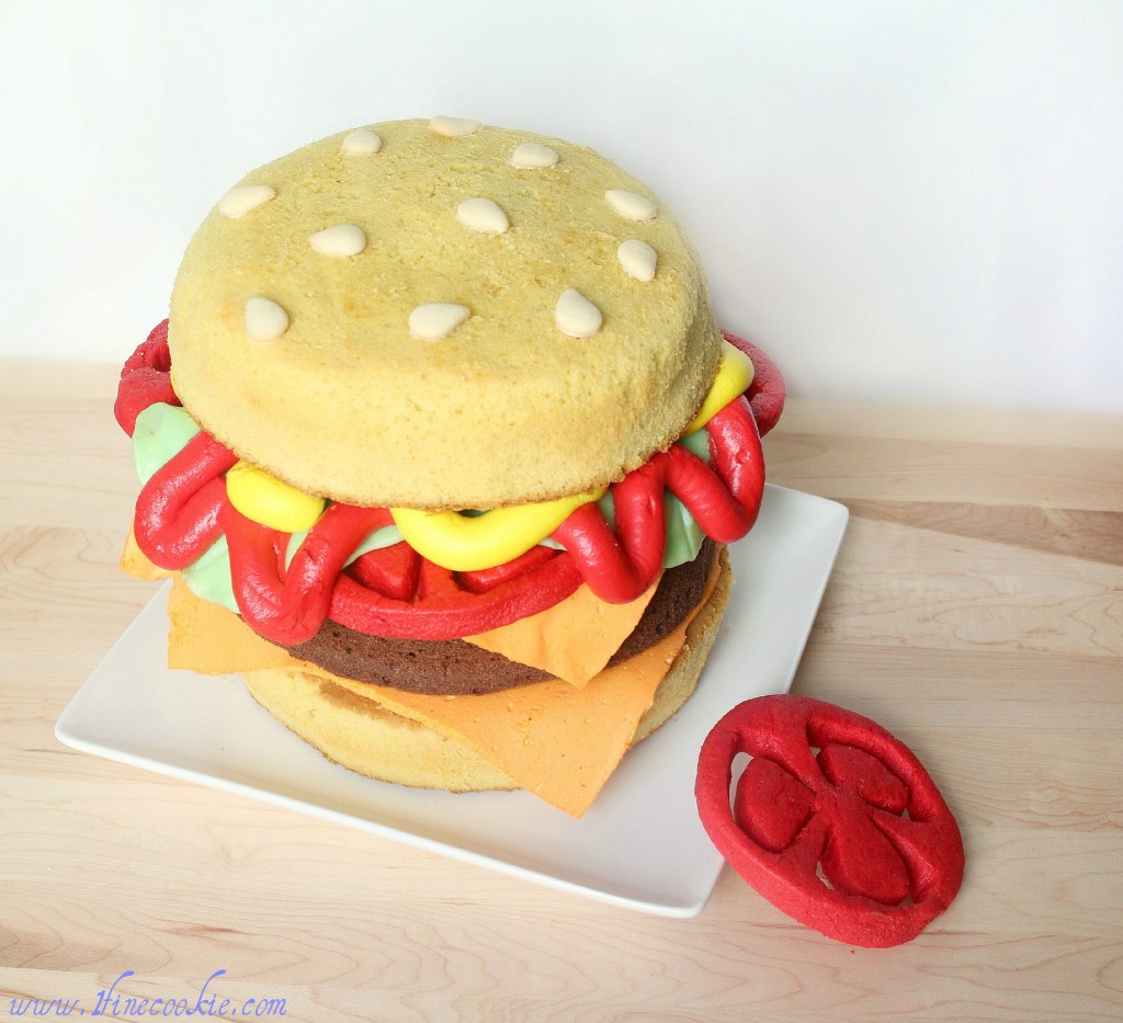hamburger and cheeseburger cake Start by layering cheese on top of the bottom burger Place on tomatoes, then lettuce bun hamburger cake cheeseburger paradise buffett parrothead