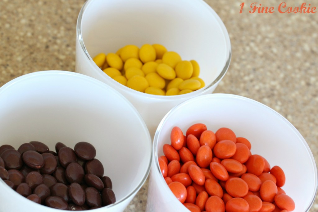 Reese's pieces, reese's, reese's pieces shots, reese's shots, reese's infused vodka, reese's infused liquor, peanut butter, infused liquor, shots, halloween, thanksgiving, cocktails, skulls, drink, diy, candy shots, candy, shot recipes, halloween shots, thanksgiving drink, orange, yellow, brown,