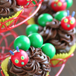 The Very Hungry Caterpillar Cupcake Toppers by 1 Fine Cookie, Hungry, Caterpillar, cake, topper, cupcake, piping, frosting, swirl, corkscrew, gum ball, decoration, how, to, idea, children, child's, kids, birthday, party, sprinkles, tootsie rolls, fondant, candy, green, red, book, literature, kindergarten, reading