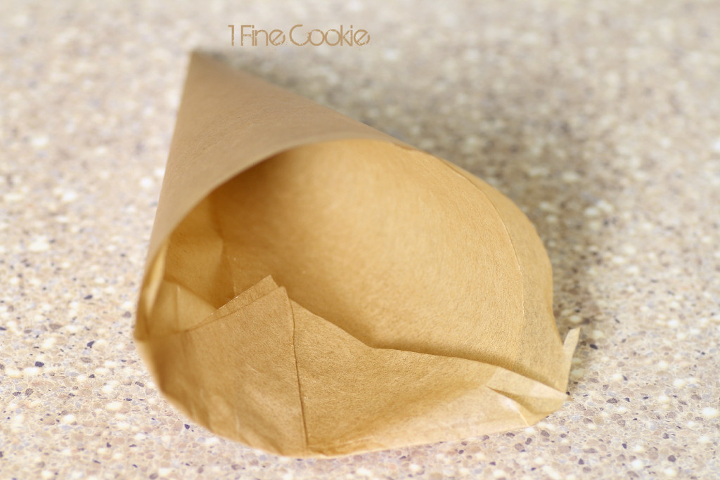How to make a parchment paper cone by 1 Fine Cookie, apple mixture, Apple pie, cinnamon, ice cream, pie crust, cone, dough, cookies, thanksgiving, leftover, recipes, homemade, custard, creamy, apple, fall, america, fourth of july, independence day, ice cream cones, parchment cone, filling, crust, cold butter, milk, bake, use, how, to, make, brown, sugar, unique, flavor, diy, food, instructions, 1 fine cookie, without, with, ice cream maker, machine, freezer,