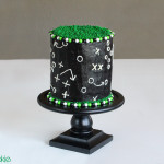 Game Play Football Cake by 1 Fine Cookie, football, cake, frosting, gameplay, game, cake, field, grass, green, black, white, cake, candy, frosting, covered, dec