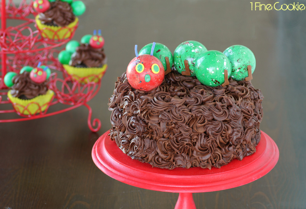 The Very Hungry Caterpillar Cake by 1 Fine Cookie, Hungry, Caterpillar, cake, topper, cupcake, piping, frosting, swirl, corkscrew, gum ball, decoration, how, to, idea, children, child's, kids, birthday, party, sprinkles, tootsie rolls, fondant, candy, green, red, book, literature, kindergarten, reading, theme, school, class, teachers, legs, antlers, easy,