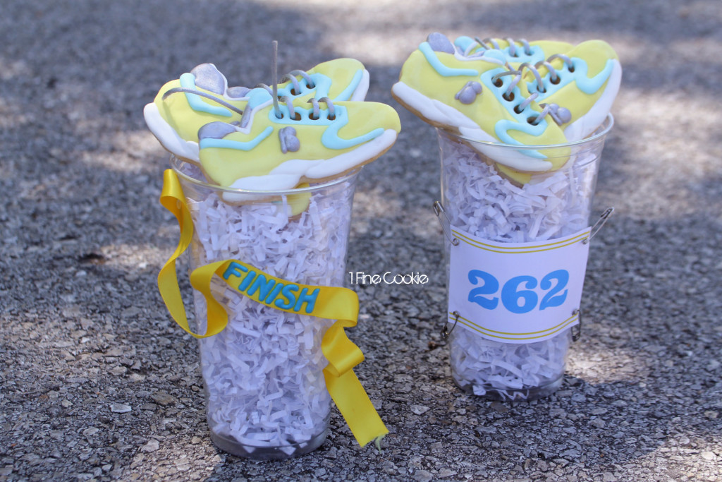 Boston Strong Marathon Sneaker Cookies - 1 Fine Cookie, boston, marathon, strong, cookies, icing, sugar, cut out, april, food, ideas, decorated, tennis, sneaker, running, shoes, ing, new york, bombing, nike, adidas, new balance, reebok, athletic, 26, miles, 5k, sports, soccer, lacrosse, party, dessert, yellow, blue, white, silver, laces, cute, fundraising, charity, donate, event, planning, inspiration, royal, outline, pipe, how to, diy, make, easy,