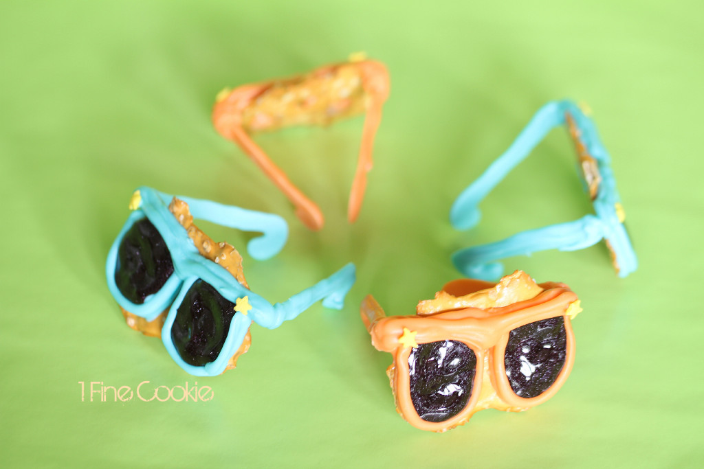 Summer Sunglasses Pretzels by 1 Fine Cookie, chocolate, covered, sunglasses, pretzels, pretzel crisps, cupcake, topper, neon, bright, summer, bbq, cookout, ideas, party, candy, melts, black, glitter, icing, white, cute, kid, friendly, recipe, fun, project, dessert, table, 4th, july, independence, day, food, porn, star, sprinkles, orange, blue, green, purple, magenta, pink, frosting, piping, birthday, teenager, hollywood, glasses, oscars, 3d, 3 dimensional, cake, salty, labor, day, memorial, weekend, tye, die, dye, colorful, cake stand,